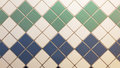 Blue, green and white real tiles in a vintage pattern. Royalty Free Stock Photo