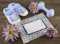 Blue greeting card with shoes and plaything tiny boy booties flowers Royalty Free Stock Photos