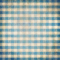 Blue grunge checked gingham picnic tablecloth background old Stock Photo