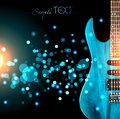 A blue guitar against a dark glitter background. Royalty Free Stock Photo