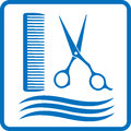 Blue hairdresser sign with hair scissors and comb Royalty Free Stock Photography