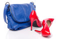 Blue handbag and red high heel shoes Royalty Free Stock Photo