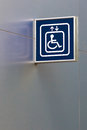 Blue handicap elevator sign on metallic wall with below copy spa space Stock Photography
