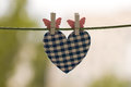 Blue heart attached to a clothesline with pin Stock Image