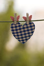 Blue heart attached to a clothesline with pin Royalty Free Stock Image