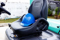 Blue helmet safety on forklift mattress Royalty Free Stock Photography