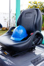 Blue helmet safety on forklift mattress Royalty Free Stock Photos