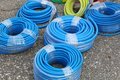 Blue hoses new packed in coils Stock Photos
