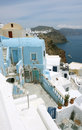 Blue house on santorini island yard and sea Stock Photography