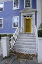 Blue house with yellow door federal style a brigh Stock Photo