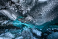 Blue ice cave with crystal in a inside alaska glacier in winter Royalty Free Stock Photo