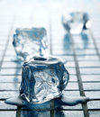 Blue Ice cubes melting Stock Images