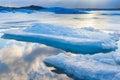 Blue ice floating in iceland with sky reflexion icebergs jokulsarlon lagoon Stock Photos