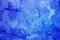 Blue Ice patterns made by the frost Royalty Free Stock Photo