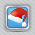 Blue icon with santa claus hat on the striped background Stock Photo
