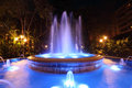 Blue illuminated fountain in marbella spain Stock Photos