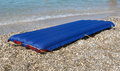 Blue inflatable raft on the sand sea beach Stock Images