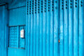 Picture : Blue iron shop door in Macau   powder