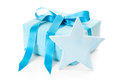 Blue isolated christmas present wrapped in paper with a star presents Royalty Free Stock Photos