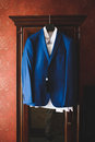 Blue Jacket on Wardrobe Royalty Free Stock Photo
