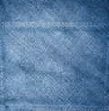 Blue jean background closeup of the texture of faded denim fabric Stock Images