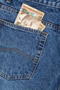 Blue jean and canadian dollars Royalty Free Stock Image