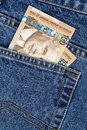 Blue jean and canadian dollars Royalty Free Stock Images