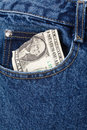 Blue jean and dollar bill Royalty Free Stock Photo