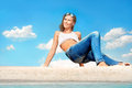 Blue jeans attractive young woman in on sea beach Royalty Free Stock Image