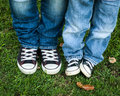 Blue jeans and black and white shoes adult and child Royalty Free Stock Photo