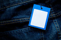 Blue jeans detail with tag Royalty Free Stock Photo