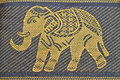 Blue jeans feather embroider elephant on a background Stock Image