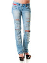 Blue jeans female legs dressed in ripped studio photo on the white background Royalty Free Stock Images