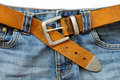 Blue jeans and leather belt Stock Images