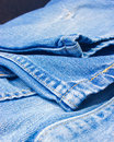 Blue jeans made of denim fabric close up shot Royalty Free Stock Images