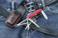 Blue jeans with multifunction penknife detail of and leather case Stock Photo
