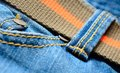 Blue jeans with orange belt macro shot Stock Images