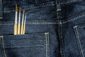 Blue jeans with paintbrush Royalty Free Stock Photo