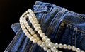 Blue jeans and pearls opposites attract infashion Royalty Free Stock Image
