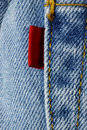 Blue jeans with red label Royalty Free Stock Photography