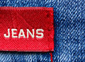 Blue jeans and red label Royalty Free Stock Photo