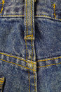 Blue jeans with seam, denim texture background, close up. Royalty Free Stock Photo