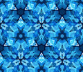 Blue kaleidoscope seamless pattern. Seamless pattern composed of color abstract elements located on white background. Royalty Free Stock Photo