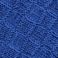 Blue knitted wool pattern texture background. Royalty Free Stock Images