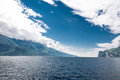 Blue lago di garda sky over lake in italy Royalty Free Stock Images