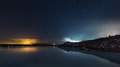 The blue lagoon on a calm night lake with light pollution from capital reykjavik lighting up clouds horizon Stock Image