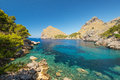 Blue lagoon at coast of  Balearic islands Royalty Free Stock Images