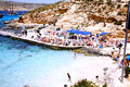 The blue lagoon comino malta beach and sundeck with holidaymakers sunbathing at Stock Images