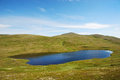 Blue lake in sloping mountains of soroya is a large island western finnmark norway the small is reflecting the sky it is the not Royalty Free Stock Photos