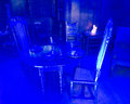 Blue light illuminating table and chairs in astley hall as part of the museums at night project chorley lancashire uk Royalty Free Stock Images